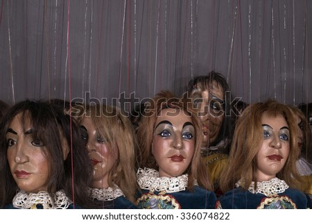 MILAN, ITALY-FEBRUARY 24, 2015: vintage dressed marionettes on backstage theatre of the Carlo Colla Company, in Milan.