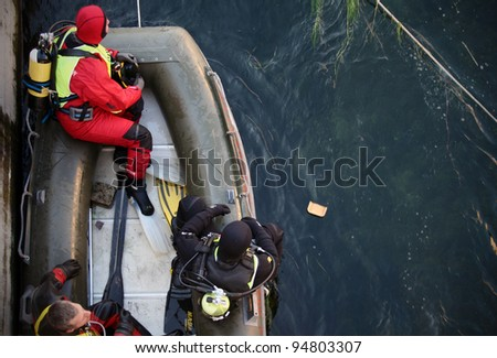 MILAN, ITALY - JAN. 26: Frogman checks security measures before historical winter swim endeavor at Naviglio Grande, main canal of the city January 26, 2009 in Milan, Italy.