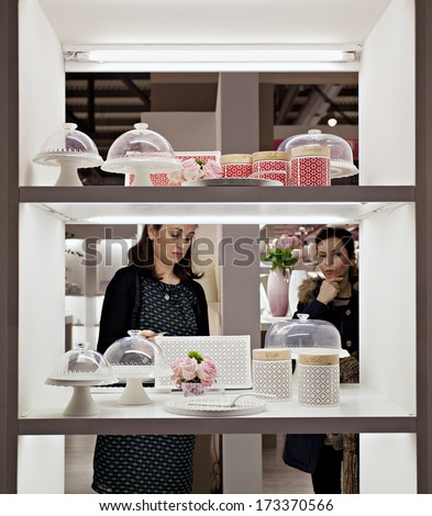 MILAN, ITALY - JANUARY 20, 2014: a couple of women's looks household items at HOMI,the new big MACEF, home international show in the sector of interior design on JANUARY 20, 2014 in Milan.  - stock photo