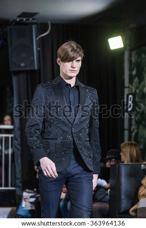 Milan, Italy - January 17, 2016 - A model walks the runway at the John Richmond Autumn Winter 2016 fashion show during Milan Menswear Fashion Week