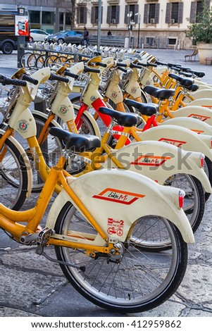 Milan, Italy - January 17, 2016: City bikes for rent parking in the historical part of Milan, Italy