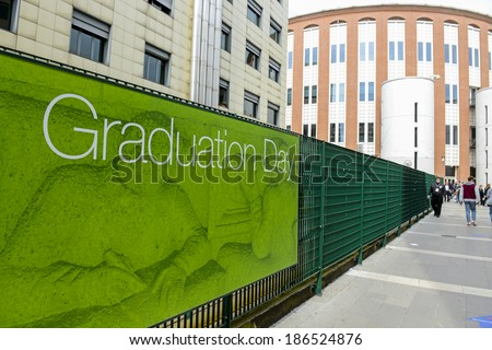 MILAN, ITALY-JANUARY 13, 2012: Green graduation day banner exposed at the Bocconi University, for the graduation day, in Milan. - stock photo