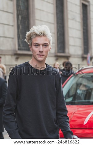 MILAN, ITALY - JANUARY 20: Model Lucky Blue Smith poses outside Cavalli fashion show building for Milan Men's Fashion Week on JANUARY 20, 2015 in Milan.
