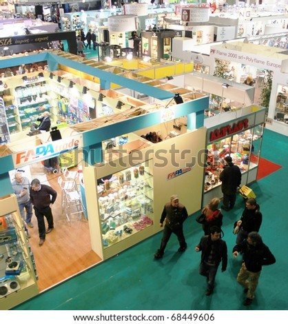 MILAN, ITALY - JANUARY 15: Panoramic view of people walking through design and accessories solutions stands at Macef, International Home Show Exhibition January 15, 2010 in Milan, Italy. - stock photo
