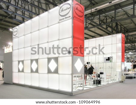 MILAN, ITALY - JANUARY 28: People look for design and interior decoration products at Macef, International Home Show Exhibition January 28, 2011 in Milan, Italy. - stock photo