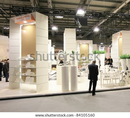 MILAN, ITALY - JANUARY 28: People visit design and interior decoration products stands at Macef, International Home Show Exhibition on January 28, 2011 in Milan, Italy.