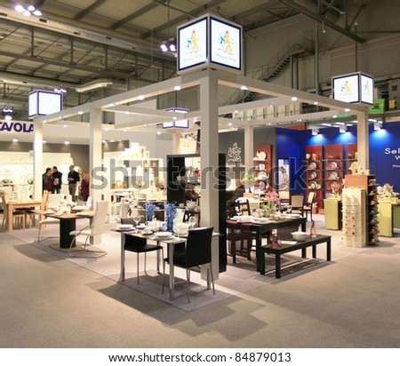 MILAN, ITALY - JANUARY 28: People visit design and interior decoration products stands at Macef, International Home Show Exhibition on January 28, 2011 in Milan, Italy. - stock photo