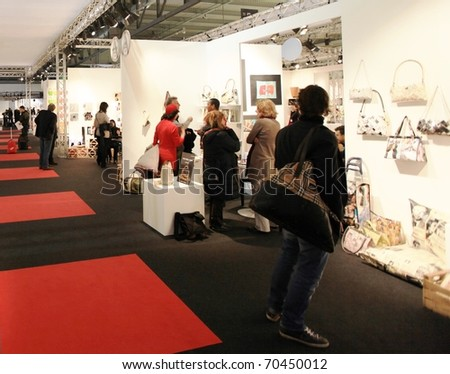 MILAN, ITALY - JANUARY 28: People visiting interior decoration stands at Macef, International annual Home Show Exhibition attracting thousands of visitors January 28, 2011 in Milan, Italy.