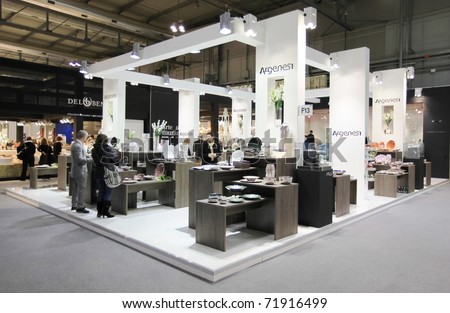 MILAN, ITALY - JANUARY 28: People walk through stands looking for design and interior decoration products at Macef, International Home Show Exhibition January 28, 2011 in Milan, Italy. - stock photo