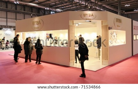 MILAN, ITALY - JANUARY 28: People walking through stands looking for design and interior decoration products at Macef, International Home Show Exhibition January 28, 2011 in Milan, Italy.