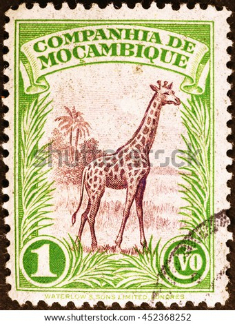 Milan, Italy - July 13, 2016: Giraffe on vintage postage stamp of Mozambique - stock photo