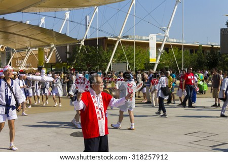 MILAN, ITALY - JULY 11, 2015: Japanese parade marching through the main EXPO street on EXPO 2015 in Italy with the theme Feeding the Planet, Energy for Life