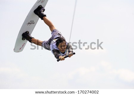 MILAN, ITALY - JULY 14: World Wakeboard Championship at the Idroscalo lake in Milan July 14, 2011. Han Qiu (CHN) during the Junior Women Quarter Finals. - stock photo