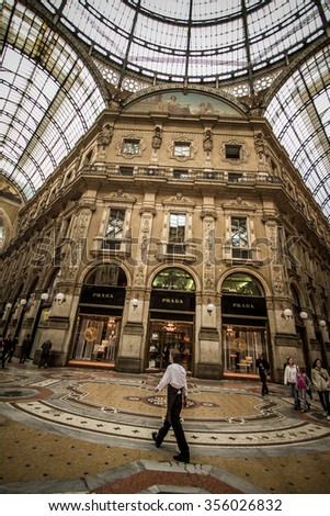 MILAN, ITALY - 4 JUN 2014: Unique view of Galleria Vittorio Emanuele II seen from above in Milan on May 2, 2012. Built in 1875 this gallery is one of the most popular shopping areas in Milan. - stock photo