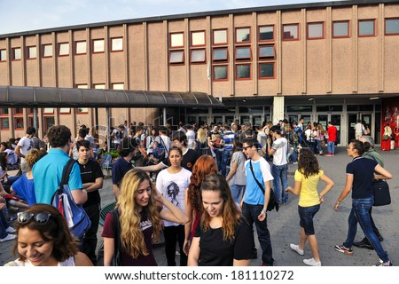 MILAN, ITALY-JUNE 20, 2012: College students before entering at school for the secondary school's final exams, at the Artemisia Gentileschi School in Milan. - stock photo