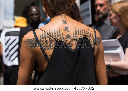 MILAN, ITALY - JUNE 18: Detail of a fashionable woman with tattoos outside Marni fashion show building for Milan Men's Fashion Week on JUNE 18, 2016 in Milan.