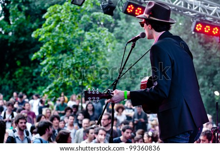 MILAN, ITALY - JUNE 12: Green Like July frontman performs live at Mi Ami outdoor summer music festival in Milan, Italy on June 12, 2011. - stock photo
