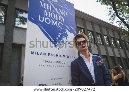 MILAN, ITALY - JUNE 20: People gather outside Armani fashion show building for Milan Men's Fashion Week on JUNE 20, 2015 in Milan.