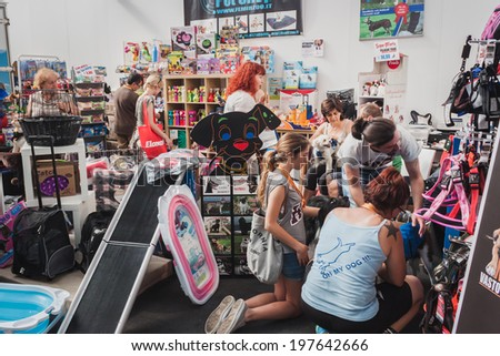 MILAN, ITALY - JUNE 7: People visit pet shop at Quattrozampeinfiera, event and activities dedicated to dogs, cats and their owner on JUNE 7, 2014 in Milan. - stock photo