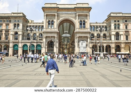 MILAN, ITALY- JUNE 11, 2015: Tourists at Milan Cathedral Square (Piazza del Duomo), The entrance to the Galleria Vittorio Emanuele II, Lombardy, Italy  - stock photo