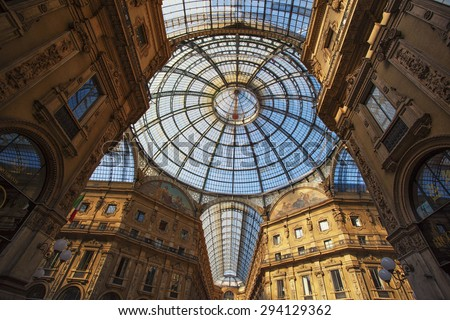 MILAN, ITALY - June 15: View of Galleria Vittorio Emanuele II, Milan on June 15, 2011. This gallery is one of the most popular shopping areas in Milan, the city chosen for Expo 2015. - stock photo