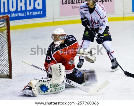 MILAN, ITALY - MAR 3: Dusan Sidor  of HC Valpellice and Edoardo Caletti of HC Milano during a game at Agora Arena on March 2, 2015, in Milan against Hc Valpellice  - stock photo