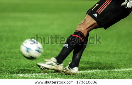 MILAN, ITALY - MARCH 22: Close up of the AC Milan goalkeeper kicking the ball during a Serie A soccer match at the San Siro stadium in Milan March 22, 2006. - stock photo