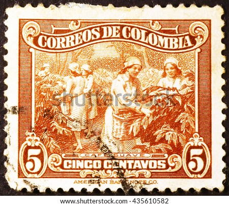 Milan, Italy - March 11, 2014: Coffee berries collection on vintage postage stamp of Colombia - stock photo