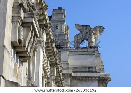 MILAN, ITALY-MARCH 23, 2015: marble decorative statue of the Central train station, in Milan.