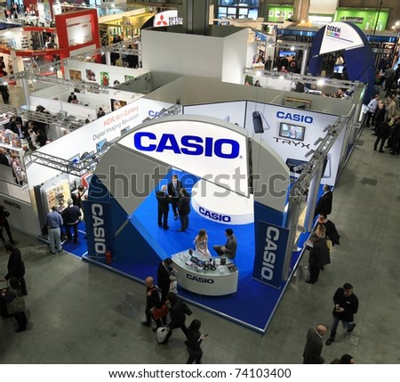 MILAN, ITALY - MARCH 26: Panoramic view of people visiting cameras, lenses and accessories stands at PHOTOSHOW, International Photo and Digital Imaging Exhibition on March 26, 2011 in Milan, Italy.