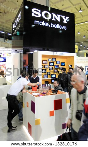 MILAN, ITALY - MARCH 26: People at Sony stand looking for cameras, lenses and accessories at PHOTOSHOW, International Photo and Digital Imaging Exhibition on March 26, 2011 in Milan, Italy.