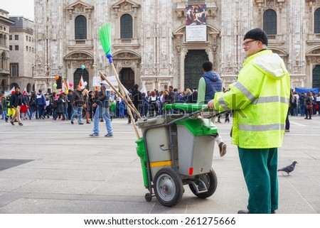 MILAN, ITALY - March 14:street cleaner look at children and parents joining the Andemm al Domm parade on March 14, 2015 in Milan, Italy. - stock photo