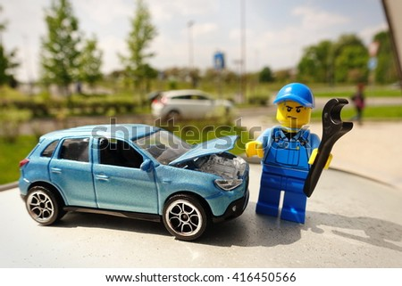 Milan, Italy - May 6 2016: A lego toy of a mechanic reparing a car, with selective focus on little car. - stock photo