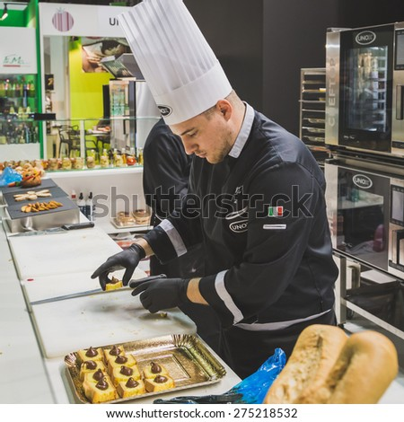 MILAN, ITALY - MAY 4:  Cook working at Tuttofood, world food exhibition on MAY 4, 2015 in Milan.
