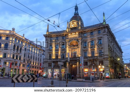 MILAN, ITALY - MAY 31: Palace of the Assicurazioni Generali in Piazza Cordusio, Milan, Italy at twilight time on May 31, 2014.  - stock photo