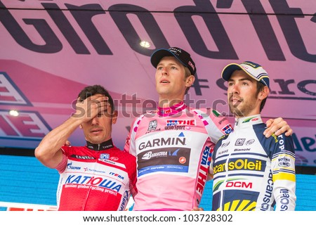 MILAN, ITALY - MAY 27: Podium of Giro d'Italia 2012 with 1st arrived Ryder Hesjedal wearing the Pink Jersey, 2nd Joaquin Rodriguez and 3rd Thomas De Gendt on May 27, 2012 in Milano, Italy - stock photo