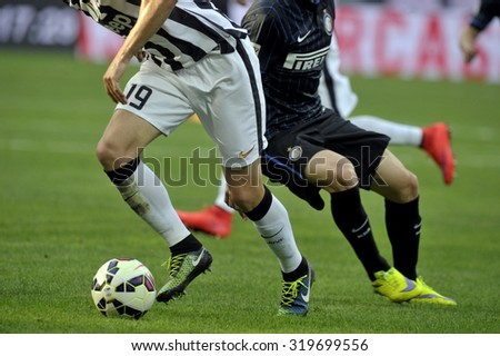 MILAN, ITALY-MAY 16, 2015: soccer players close up legs in action during the italian league serie A match FC Internazionale vs Juventus at the San Siro stadium, in Milan.