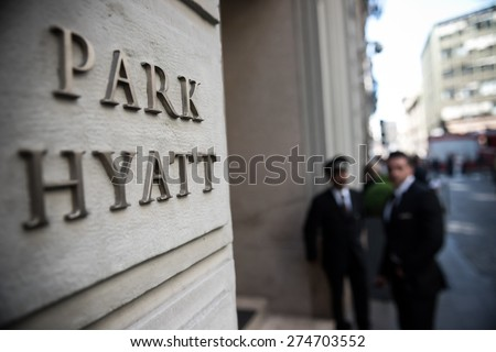 MILAN, ITALY - MAY 2: The Park Hyatt Milan hotel entrance in Milan on May 2, 2015. Occupying a building dating back to 1870, the boutique hotel is one of the most luxurious accommodations in Milan. - stock photo
