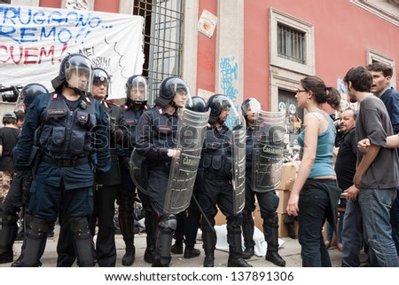 MILAN, ITALY - MAY 7: University students during a protest march in Milan MAY 7, 2013. University students march in the streets to protest against  the evacuation of their occupied bookstore by police - stock photo