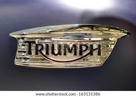 MILAN, ITALY - NOV 5: brand of Triumph at EICMA, 71 th International Motorcycle Exhibition November 5, 2013 in Milan, Italy.  - stock photo
