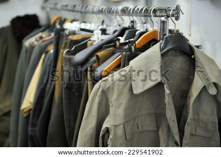 MILAN, ITALY - NOV 1: Military jackets, Exhibitor sitting in his stand at Militalia, exhibition dedicated to militaria collectors and military associations on November 1, 2014 in Milan. - stock photo