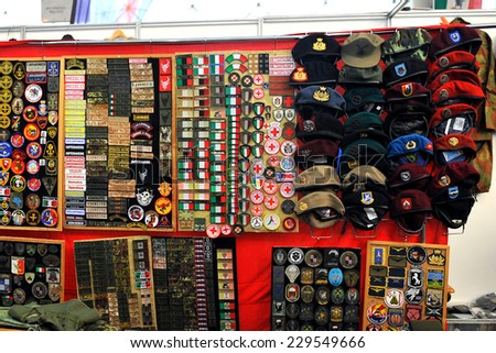 MILAN, ITALY - NOV 1: Miscellaneous items , Exhibitor sitting in his stand at Militalia, exhibition dedicated to militaria collectors and military associations on November 1, 2014 in Milan. - stock photo