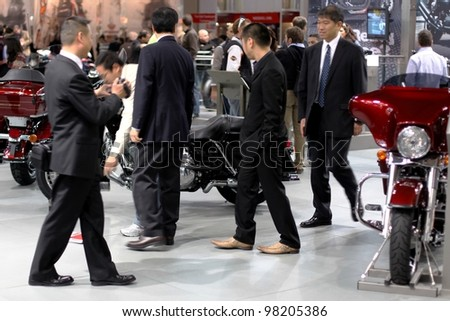 MILAN, ITALY - NOV. 11: People visit motorcycle exhibition area at EICMA, 67th International Motorcycle Exhibition November 11, 2009 in Milan, Italy.