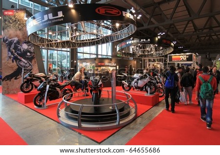 MILAN, ITALY - NOV. 03: People walk trough stands at EICMA, 68th International Motorcycle Exhibition November 03, 2010 in Milan, Italy.