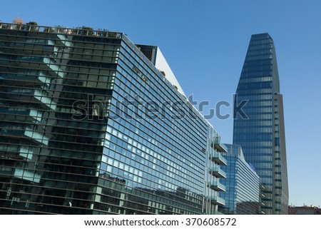 MILAN, ITALY - NOVEMBER 7, 2015: Diamond Tower and the Diamantini Buildings designed by the Kohn Pederson Fox in the Porta Nuova district in Milan, Italy. - stock photo