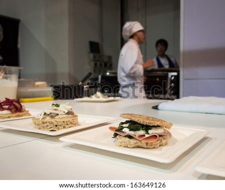 MILAN, ITALY - NOVEMBER 18: Focaccia bread interpreted by chef at Golosaria, important event dedicated to culture and tradition of quality food and wine on NOVEMBER 18, 2013 in Milan. - stock photo