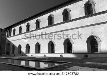 MILAN, ITALY - NOVEMBER 22, 2015: Milan (Lombardy, Italy): internal court of the medieval castle known as Castello Sforzesco (built at end of 15th century). Black and white