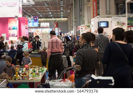 MILAN, ITALY - NOVEMBER 22: People visit G! come giocare, trade fair dedicated to games, toys and children on NOVEMBER 22, 2013 in Milan.