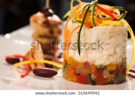 MILAN, ITALY - NOVEMBER 18: Rice and vegetables interpreted by chef at Golosaria, important event dedicated to culture and tradition of quality food and wine on NOVEMBER 18, 2013 in Milan. - stock photo
