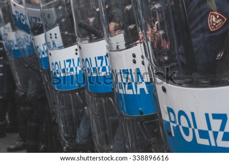 MILAN, ITALY - NOVEMBER 13: Riot police confronting the students during a march in the city streets to protest agaist the public school management on NOVEMBER 13, 2015 in Milan.